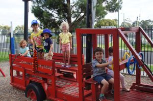 Kids having fun on the play firetruck at Concord Playgroup